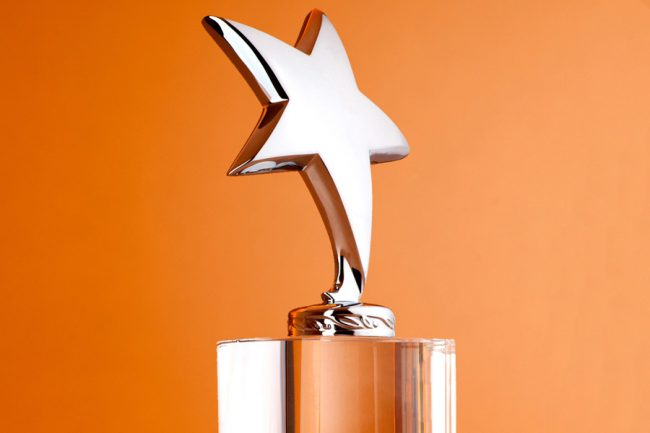Award in the shape of a stat on an orange background